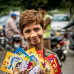 Poor Boy Selling Books To Feed His Younger Brothers And Sisters In Lahore