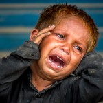 Poor Boy Weeping After Loosing His Mother In A Crowd